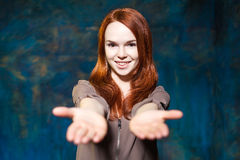 Beautiful girl with red hair stretching hands to the camera Stock Images