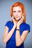 Beautiful girl with red hair in studio Stock Photo