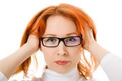 A beautiful girl with red hair wearing glasses stock images