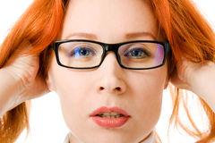 A beautiful girl with red hair wearing glasses royalty free stock photo