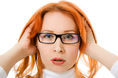 Beautiful girl with red hair wearing glasses stock image