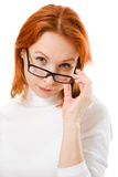 Beautiful girl with red hair wearing glasses Royalty Free Stock Photos