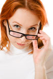 Beautiful girl with red hair wearing glasses Stock Photography