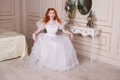 Beautiful girl with red hair Royalty Free Stock Photography