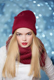 Beautiful girl in a red hat at a Christmas garland Stock Image