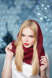 Beautiful girl in a red hat at a Christmas garland Stock Photography