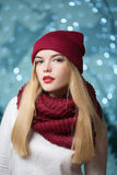 Beautiful girl in a red hat at a Christmas garland Stock Images