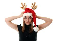 Beautiful girl in red hat santa and golden branch Royalty Free Stock Photo