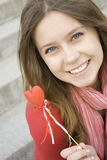 Beautiful girl with a red heart Stock Image