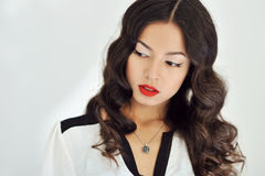 Beautiful girl with red lips and curly black hair on white backg Stock Photography