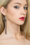 Beautiful girl with red lips and earrings. fashion Stock Image