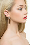 Beautiful girl with red lips and earrings. fashion Royalty Free Stock Images