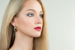 Beautiful girl with red lips and earrings. fashion Royalty Free Stock Photos