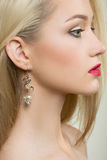 Beautiful girl with red lips and earrings. fashion Stock Photo
