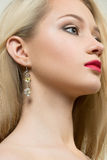 Beautiful girl with red lips and earrings. fashion Royalty Free Stock Image