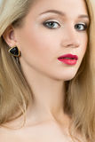 Beautiful girl with red lips and earrings. fashion Stock Photography