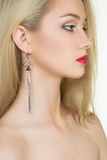 Beautiful girl with red lips and earrings. fashion Royalty Free Stock Photography