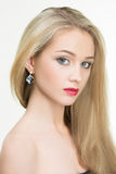 Beautiful girl with red lips and earrings. fashion. Portrait of beautiful blond woman with earring. Perfect makeup. Fashion photo Royalty Free Stock Photos