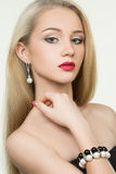 Beautiful girl with red lips. earrings and Stock Images
