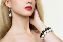 Beautiful girl with red lips. earrings and Royalty Free Stock Photos