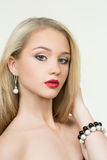 Beautiful girl with red lips. earrings and Stock Photos