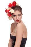 Beautiful girl with red lips and flowers in head Stock Photography