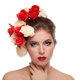 Beautiful girl with red lips and flowers in head Royalty Free Stock Images