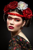 Beautiful girl with red lips and flowers Royalty Free Stock Images