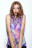 Beautiful girl with red lips and purple curls. Stock Photos