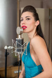 Beautiful girl with red lips sing in room Stock Photo