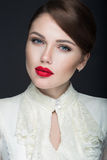 Beautiful girl with red lips in white clothes in the form of retro. Beauty face. Stock Photo