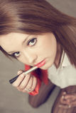 Beautiful girl with red lipstick at soft light Stock Photos