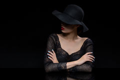 Beautiful girl with red llips in black hat Stock Photo