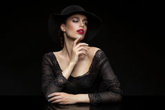 Beautiful girl with red llips in black hat Stock Images