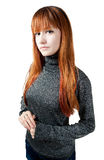 The beautiful girl with red long hair in a sweater. Isolated on white Royalty Free Stock Photo