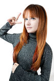 The beautiful girl with red long hair in a sweater. Isolated on white Stock Photos