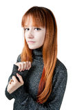 The beautiful girl with red long hair in a sweater. Isolated on white Royalty Free Stock Photography
