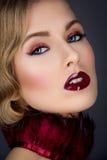Beautiful girl with red makeup stock photos