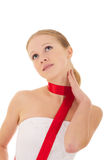 Beautiful girl with a red ribbon. Beautiful young woman with a red silk ribbon royalty free stock photo
