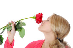 Beautiful girl with a red rose. Isolated on white background Stock Image