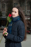 Beautiful girl and red rose Royalty Free Stock Photography