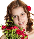 Beautiful girl with red roses Royalty Free Stock Photos