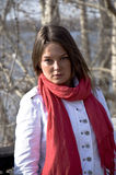 Beautiful girl in a red scarf. Portrait of a young beautiful girl in a red scarf. Outdoor scene. Close up Royalty Free Stock Photo