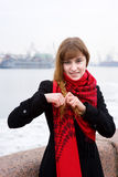 Beautiful girl in the red scarf braiding hair Royalty Free Stock Images