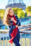 Beautiful girl in red scarf on a fall day in Paris Stock Photography
