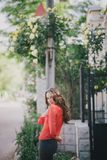 Beautiful girl in a red shirt posing on a street Stock Images
