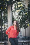 Beautiful girl in a red shirt posing on a street Royalty Free Stock Photography