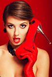 Beautiful girl with red shoes Royalty Free Stock Image