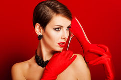 Beautiful girl with red shoes Stock Images