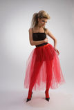 Beautiful girl in red skirt Royalty Free Stock Photography